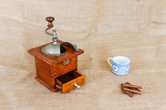 Coffee, cup and grinder. Assembly performed in studio Royalty Free Stock Images