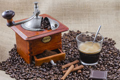 Coffee, cup and grinder. Assembly performed in studio Stock Photos