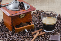 Coffee, cup and grinder. Assembly performed in studio Stock Images