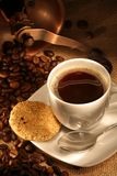 Coffee cup with grinder, fresh beans and cookies Royalty Free Stock Image