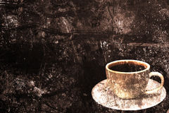 Coffee cup on a grunge background Royalty Free Stock Photo