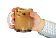 Coffee cup in hand Stock Images