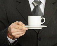 Coffee cup in hand, a businessman - need a break Stock Images
