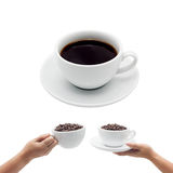 Coffee cup and hand of a woman holding a cup of coffee Royalty Free Stock Photos