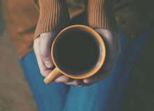 Coffee cup in hands Stock Photo