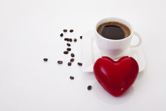 Coffee cup with heart and coffee beans Stock Images