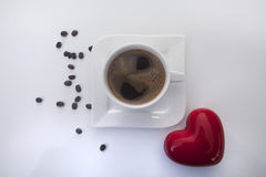 Coffee cup with heart and coffee beans Royalty Free Stock Photos