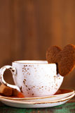 Coffee cup and heart cookie Stock Images
