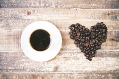 Coffee cup and heart Stock Image