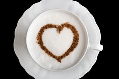 Coffee cup with heart shape. Coffee cappuccino cup with cinnamon heart shape Stock Image