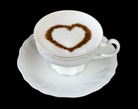 Coffee cup with heart shape. Coffee cappuccino cup with cinnamon heart shape on black Stock Photography