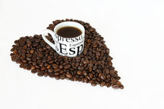 Coffee cup in heart shape beans Stock Image