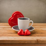 Coffee cup with heart shape chocolate Stock Images