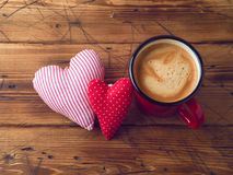 Coffee cup and heart shape. Over wooden background. Valentines day concept. Top view stock image
