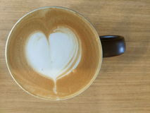 Coffee cup with heart shape latte art Stock Photography