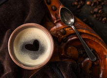 Coffee cup with heart shape made of foam on old colonial wooden table, top view Stock Photography