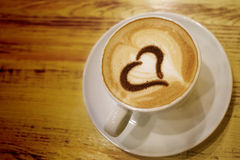 Coffee cup with  heart shape Stock Photos