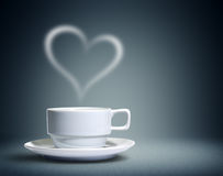 Coffee cup with heart shaped royalty free stock photos