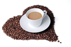 Coffee cup with heart shaped coffee beans Stock Images
