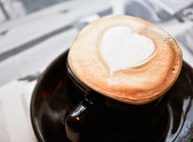 Coffee cup with heart shaped foam Stock Image