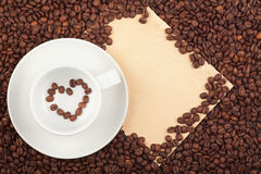 Coffee cup with heart symbol and paper Stock Photo