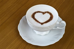 Coffee cup with heart on table Royalty Free Stock Image