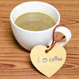 Coffee cup with heart tag write I love coffee word Stock Images