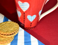 Coffee cup with hearts and cookies Stock Image