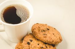 Coffee cup and homemade cookies with chocolate/Breakfast whith coffee cup and homemade cookies with chocolate, close up. White biscuits food cake oat pastries stock images