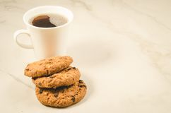 Coffee cup and homemade cookies with chocolate/ Breakfast whith coffee cup and homemade cookies with chocolate, copyspace. Coffee cup and homemade cookies with royalty free stock photos