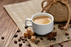 Coffee. Cup Of Hot Beverage. Close Up Of Mug Of Hot Drink With Coffee Foam Near Brown Sugar Cubes, Spice And Coffee Beans On Wooden Table. High Resolution Royalty Free Stock Photos