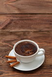 Coffee. A cup of hot coffee with a hint of cinnamon each day in the morning to awaken the best Stock Image