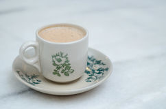 Coffee in cup. Hot coffee in a cup on table royalty free stock photos