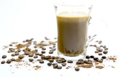 Coffee. A cup of hot coffee on a white background. Abstract background with with coffee beans and ground coffee Royalty Free Stock Images