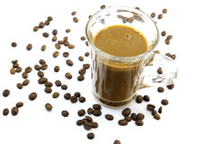 Coffee. A cup of hot coffee on a white background. Abstract background with with coffee beans and ground coffee Royalty Free Stock Photo