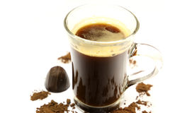 Coffee. A cup of hot coffee on a white background. Abstract background with cocoa and candy Royalty Free Stock Image