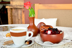 Coffee, cup of ice-cream and vase with red rose Royalty Free Stock Photos