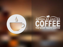 Coffee cup icon and text design with a blurred background. Stock Photo