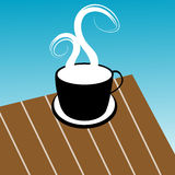 Coffee cup illustration. On a wooden table with blue background Stock Photo