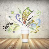 Coffee cup with illustrations Royalty Free Stock Images