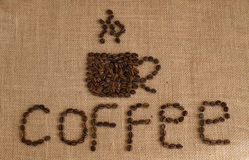 Coffee cup image made up of coffee beans on burlap background Stock Photos