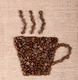 Coffee cup image made up of coffee beans on canvas background Royalty Free Stock Image