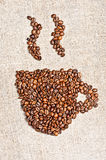 Coffee cup image made up of coffee beans on sack Royalty Free Stock Image