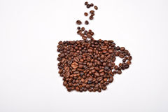 Coffee cup image made up of coffee beans on a white background Stock Photography