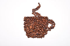 Coffee cup image made up of coffee beans on a white background Royalty Free Stock Images