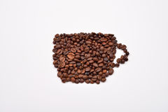 Coffee cup image made up of coffee beans on white background Stock Photography
