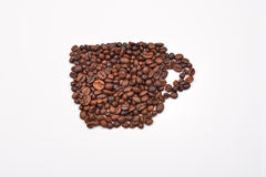Coffee cup image made up of coffee beans on white background Stock Image
