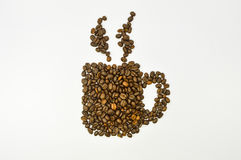 Coffee cup image made up of coffee beans on white background Royalty Free Stock Image