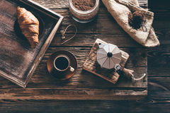 Coffee cup and ingredients on old wooden table Royalty Free Stock Images