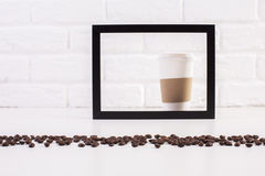 Coffee cup inside frame Royalty Free Stock Photos